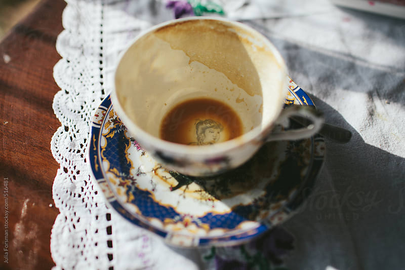 Empty vintage coffee cup. by Julia Forsman for Stocksy United