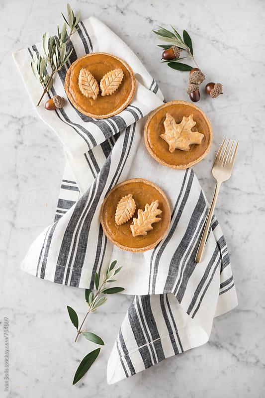 Mini pumpkin pies  by Ivan Solis for Stocksy United