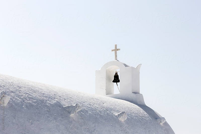 Roof and bell tower of a white church in Oia, Santorini by Paul Phillips for Stocksy United