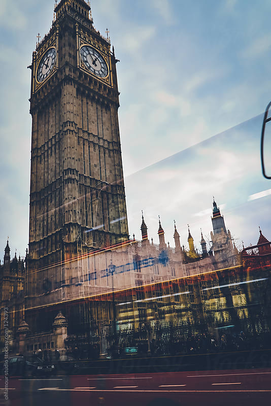 Bus passing with big ben on background by Leandro Crespi for Stocksy United