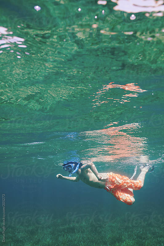 Underwater boy snorkelling by Dana Pugh for Stocksy United