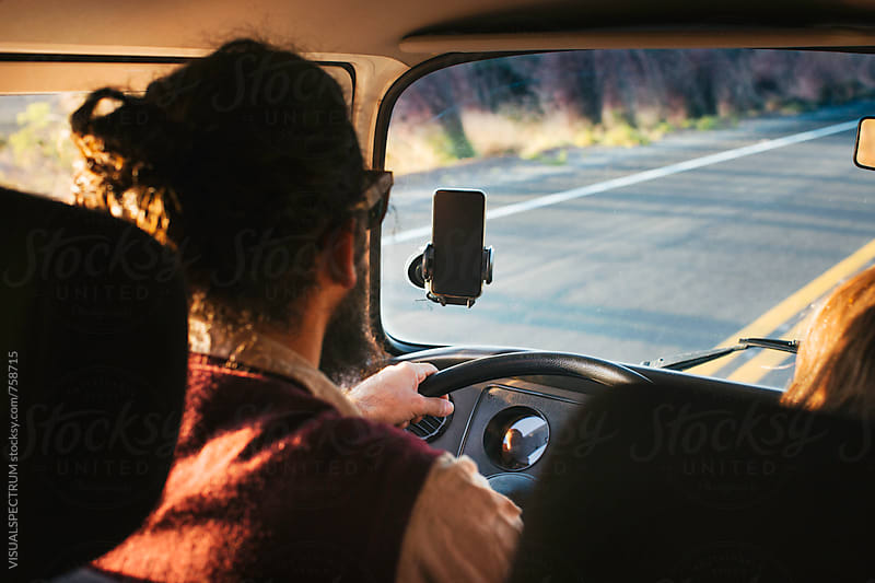 On The Road - Male Bearded Hippie Driving Camper Van in Warm Afternoon Sunlight by Julien L. Balmer for Stocksy United