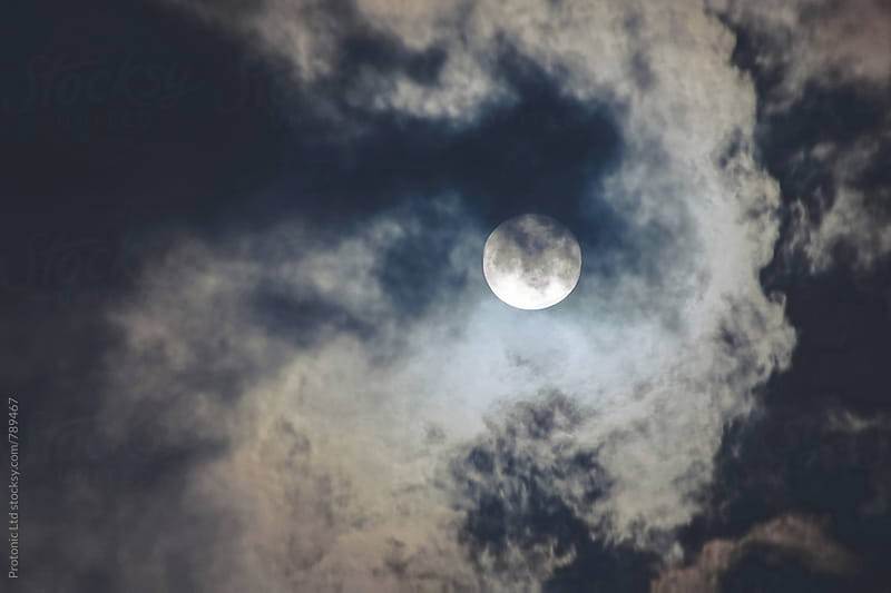 Dark cloudy sky with full moon by Per Swantesson for Stocksy United