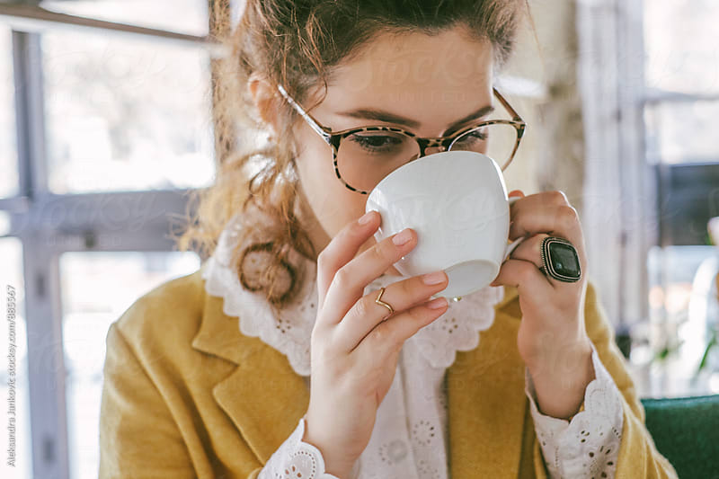 Stylish Young Woman Drinking Tea by Aleksandra Jankovic for Stocksy United