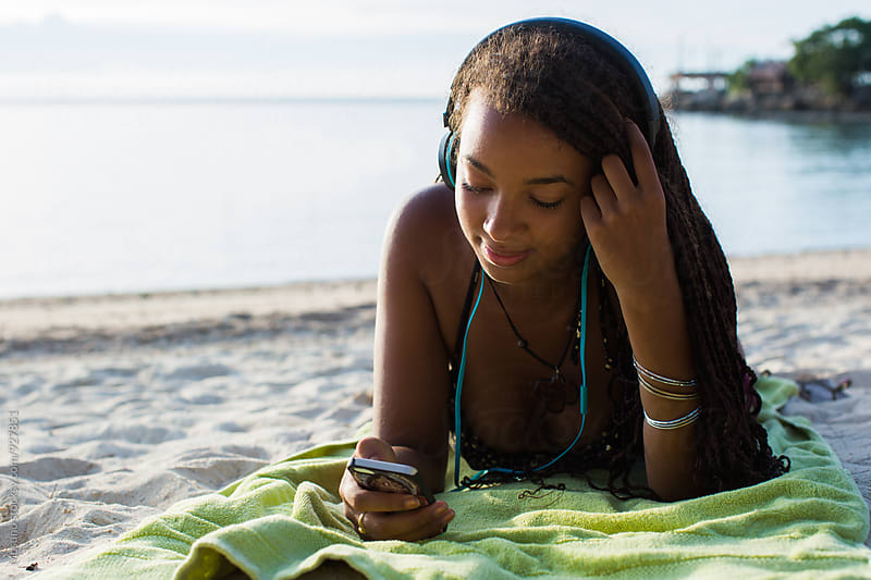 Young Black Woman Listening to Music by Mosuno for Stocksy United
