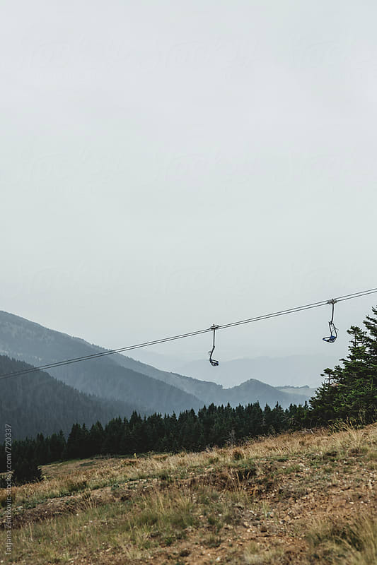 Chairlift in mountain by Tatjana Ristanic for Stocksy United