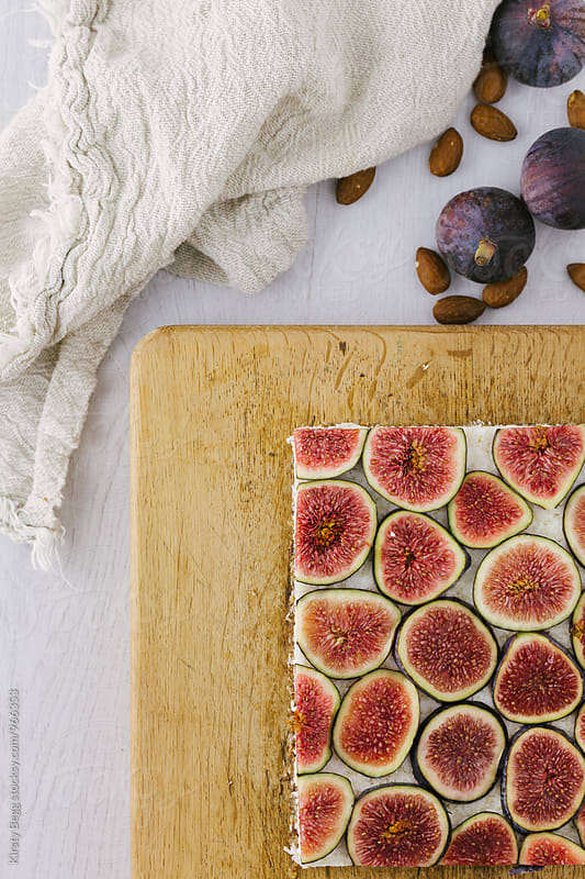 Clean eating fig slice dessert bar from above by Kirsty Begg for Stocksy United