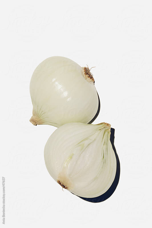 Onion halves by Ania Boniecka for Stocksy United