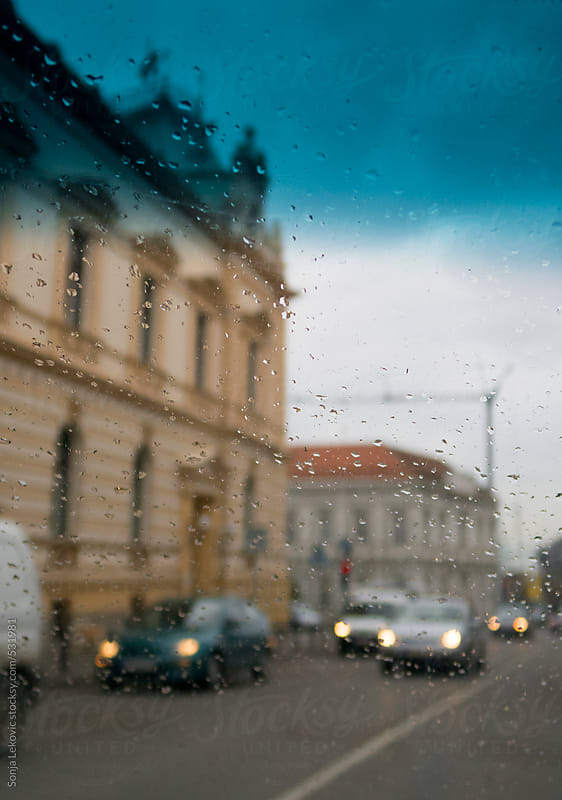 street in blur on a rainy day by Sonja Lekovic for Stocksy United