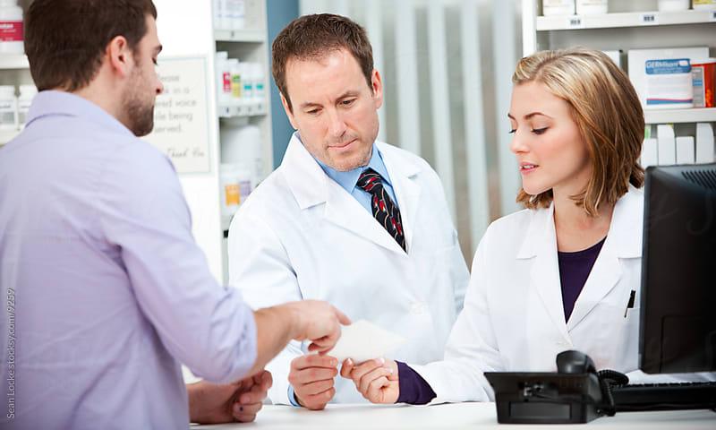 Pharmacy: Customer Has Question About Medicine Prescription by Sean Locke for Stocksy United