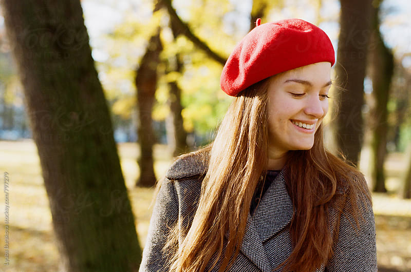 Happy woman wearing beret by Lyuba Burakova for Stocksy United
