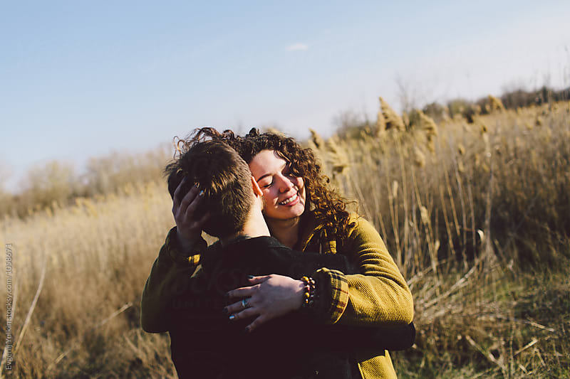 Young embracing couple   by Evgenij Yulkin for Stocksy United