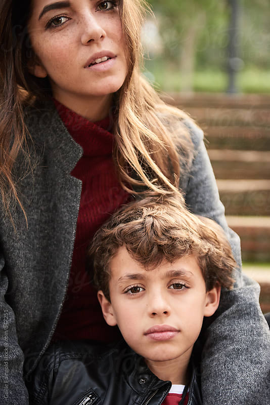 Close-up of beautiful mother and son in park by Guille Faingold for Stocksy United