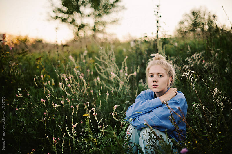 Young blonde woman  has a rest outdoors by Sergey Filimonov for Stocksy United