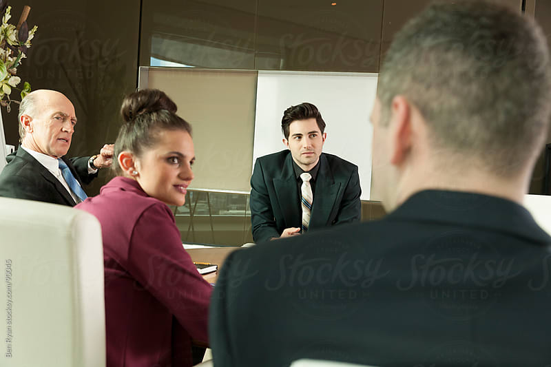 Corporate meeting room discussion by Ben Ryan for Stocksy United