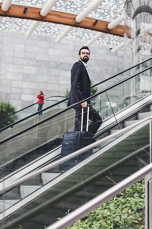 Elegant Businessman using escalators by Mauro Grigollo for Stocksy United