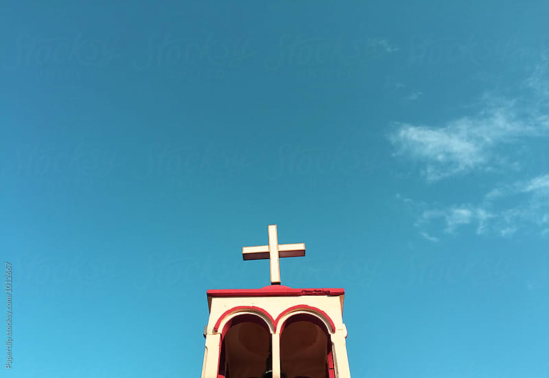 Church steeple with cross by Paperclip Images for Stocksy United