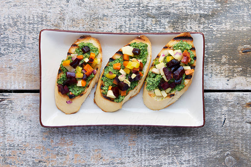Roasted Fall Veggie Bruschetta with Kale, Sage and Chive Pesto by Harald Walker for Stocksy United