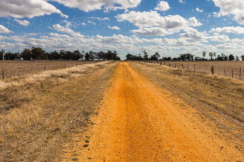 empty red dirt road in country Victoria, Australia by Gillian Vann for Stocksy United