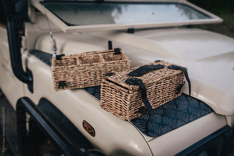 Two woven baskets on safari car for sundowner by Trent Lanz for Stocksy United