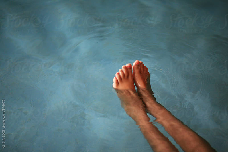 Legs In the Pool by ALICIA BOCK for Stocksy United