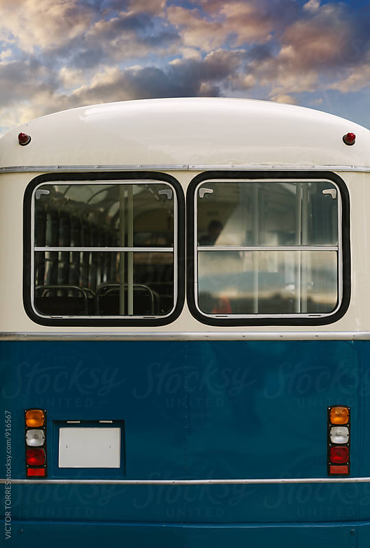 Detail of an Old Bus Parked in the Street at Sunset by Victor Torres for Stocksy United