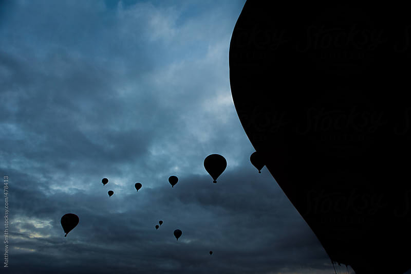 Group Of Hot Air Balloons Ascending In The Early Morning by Matthew Smith for Stocksy United