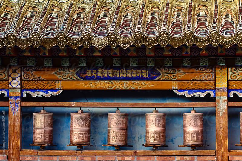 prayer wheels in lama temple by zheng long for Stocksy United