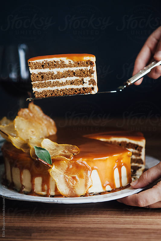 Gingerbread cake with caramel and pear wafers by Ellie Baygulov for Stocksy United