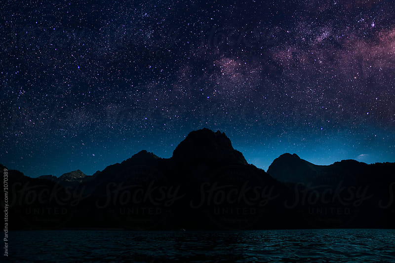 Mountains at night by Javier Pardina for Stocksy United