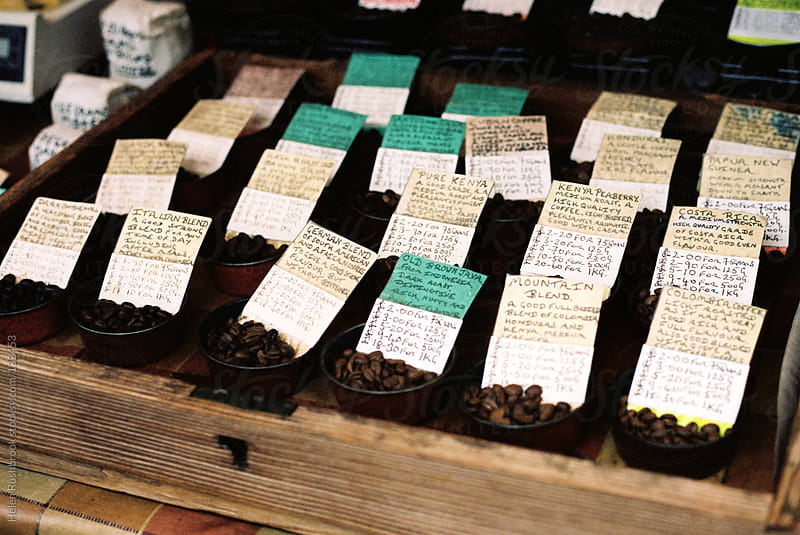Coffee beans on a market stall by Helen Rushbrook for Stocksy United