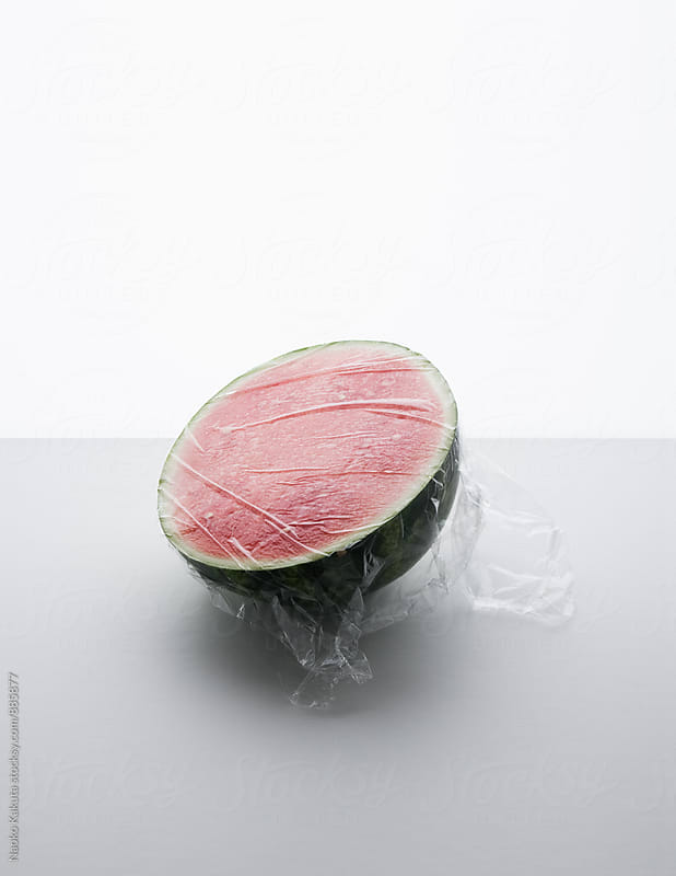 watermelon wrapped in plastic by Naoko Kakuta for Stocksy United