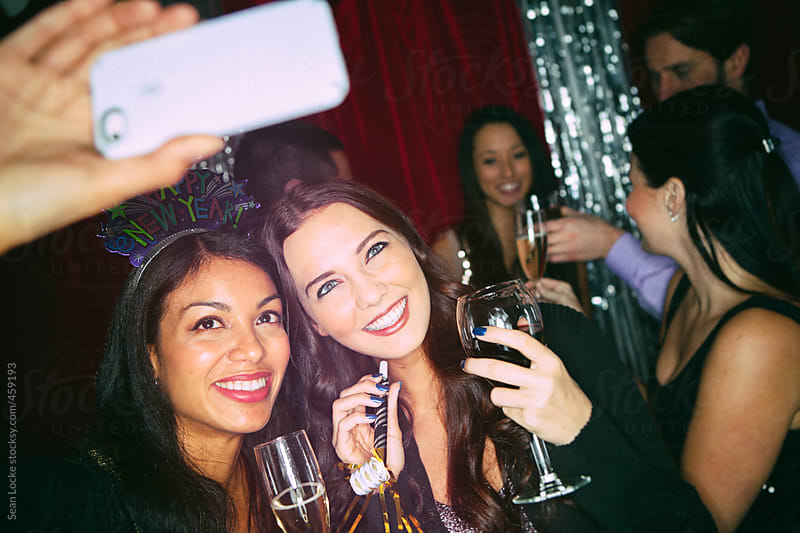 Party: Two Friends Pose For A Selfie by Sean Locke for Stocksy United