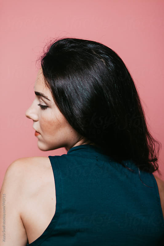 Woman looking over her shoulder by Kayla Snell for Stocksy United