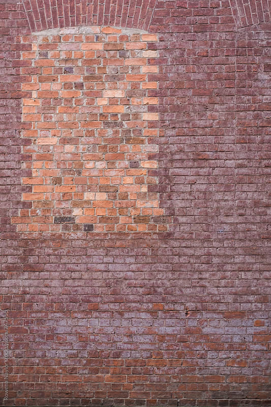 Brick wallk and bricked in window by Rowena Naylor for Stocksy United