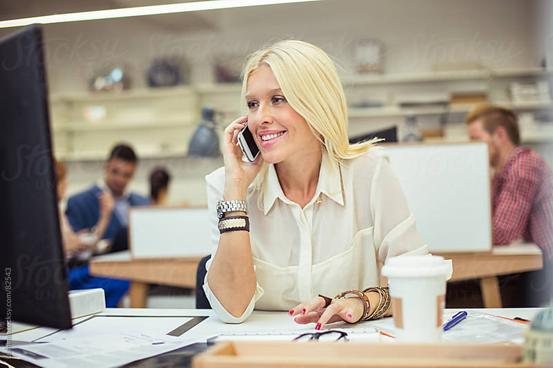 Smiling Businesswoman Telephoning by Lumina for Stocksy United