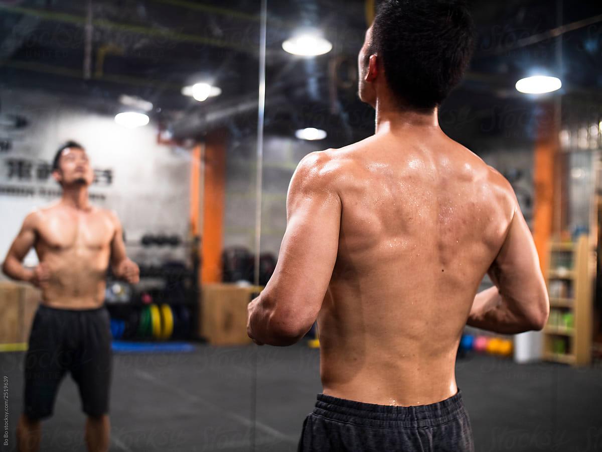 Asian man in Gym by Bo Bo - Stocksy United