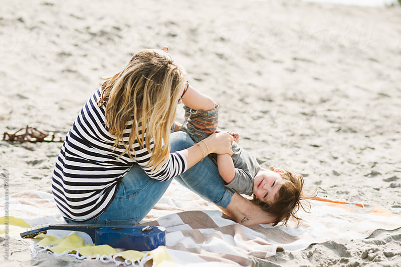Young mother and son playing at the beach by Kate Daigneault for Stocksy United