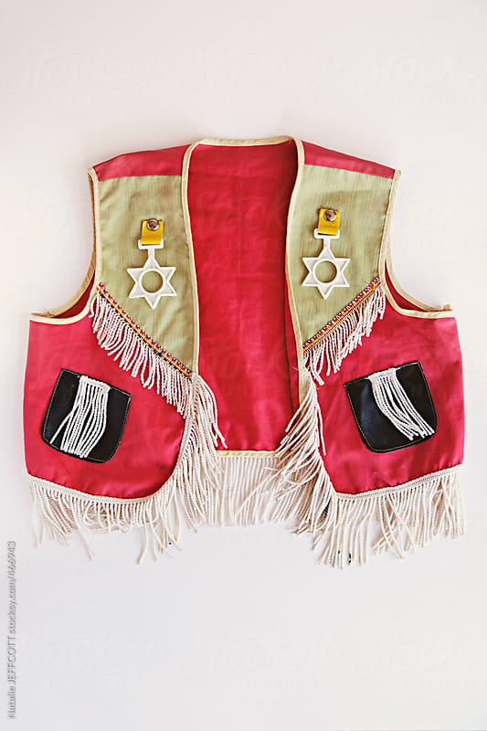 overhead view of a vintage child's cowboy dress up outfits by Natalie JEFFCOTT for Stocksy United