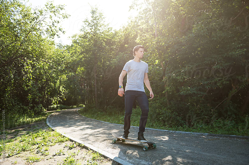 Man riding on longboard by Milles Studio for Stocksy United