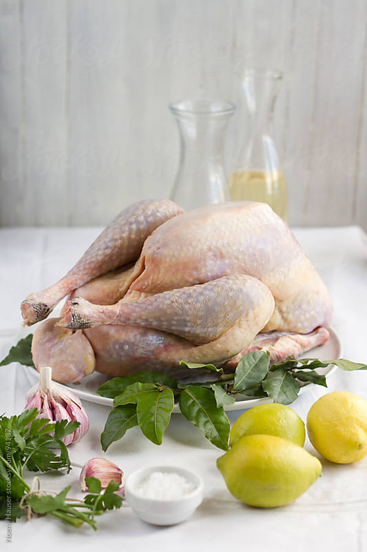 Turkey with bay leaf and lemons by Noemi Hauser for Stocksy United