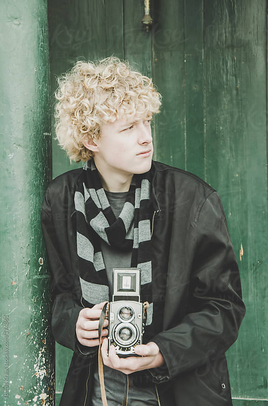 Young Man Taking Photos with a Vintage Camera by Tomas Kraus for Stocksy United