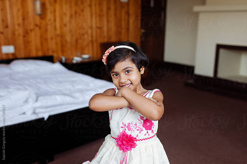 Little girl reciting rhymes and smiling by Saptak Ganguly for Stocksy United