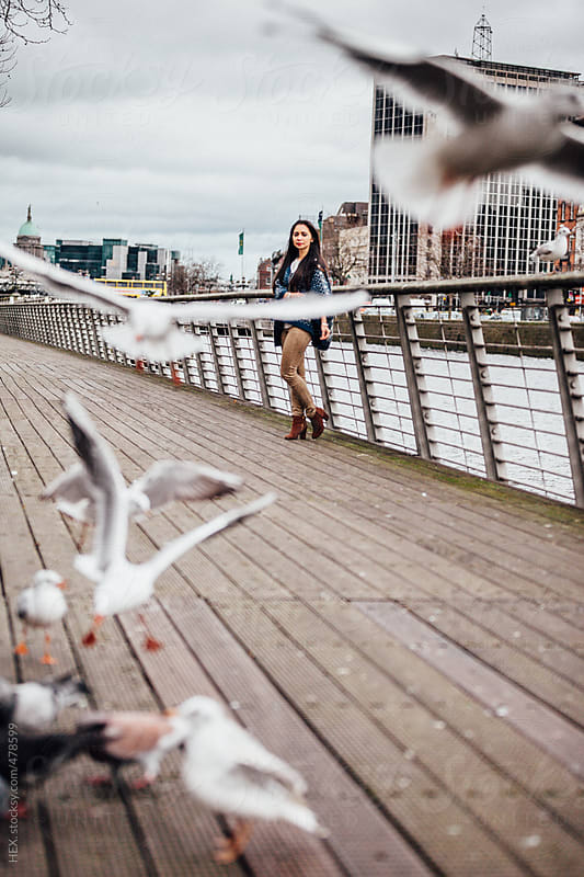 Girl Having Fun Playing with Seagulls  by HEX. for Stocksy United