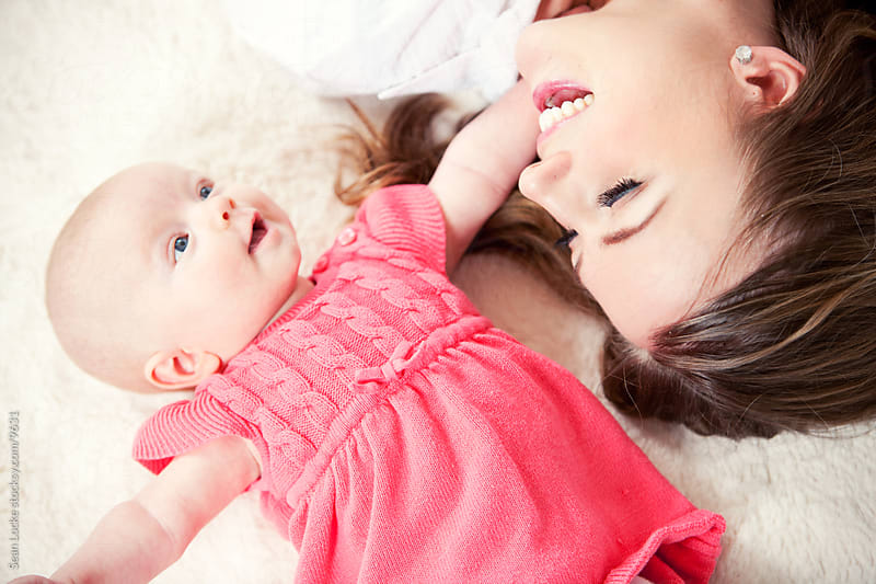 Baby: Mommy Lying on Floor with Baby by Sean Locke for Stocksy United