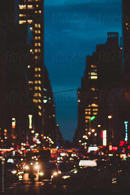New York City street at night by Lauren Naefe for Stocksy United