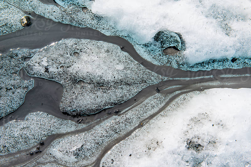 heart shape in glacial silt melt runoff by Tara Romasanta for Stocksy United