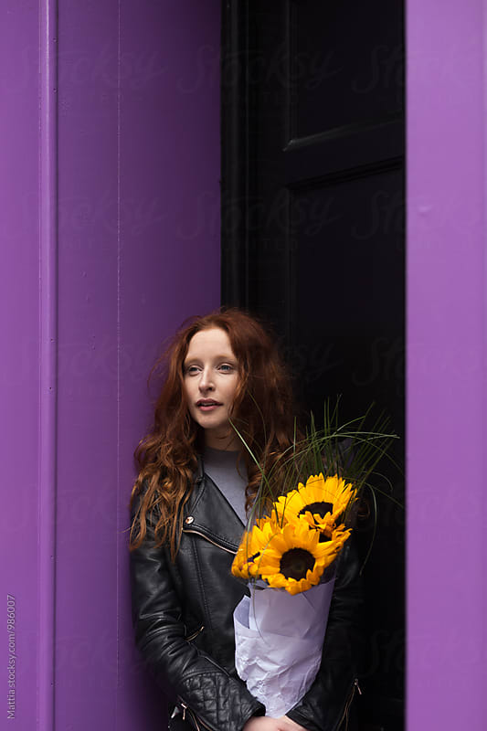 Young Beautiful Girl Holding Sunflowers out of Her House  by HEX . for Stocksy United