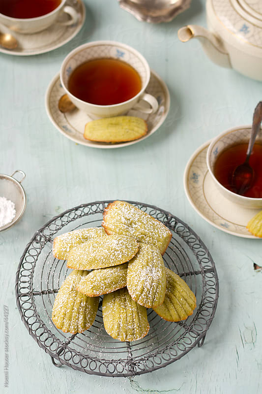 Pistachio madeleines with three cups of tea by Noemi Hauser for Stocksy United