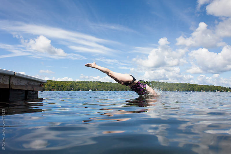 Woman Diving into Cottage Lake by JP Danko for Stocksy United